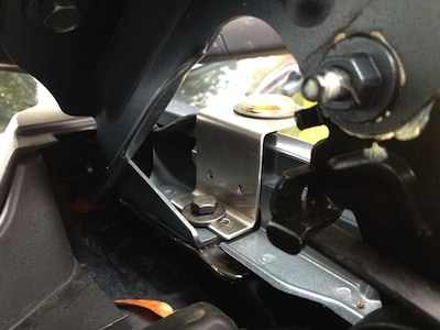 Interior shot showing the mount and the fender bolt on a GMC Sierra Pickup