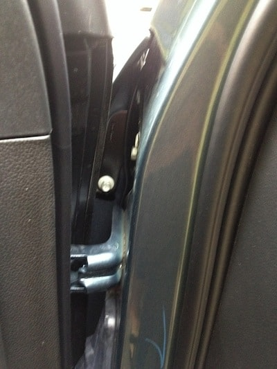 cable running from the inner side of the fender into the door frame on a GMC Sierra Pickup