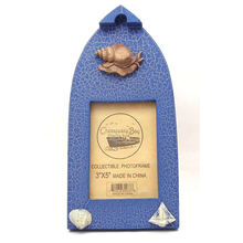 "12539933C-B - Wooden Boat Shaped 3"" X 5"" Blue Picture Frame w/ Snail & Shell Embellishments"