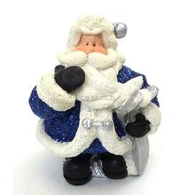 "1256553A - 6"" Resin Royal Blue Glitter Santa Statue Holding Skis"